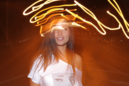 Head and shoulders image of a  young girl with lightpainting, long time exposure Stock Photo - 28496707