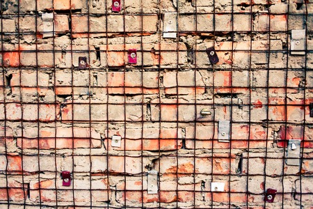 treadplate: Red brick wall with iron grid over Stock Photo