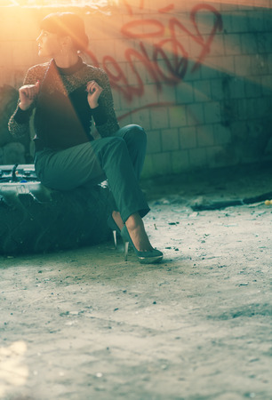 glamur: Glamur girl posing in fashion style in slums, a lot of copyspace Stock Photo