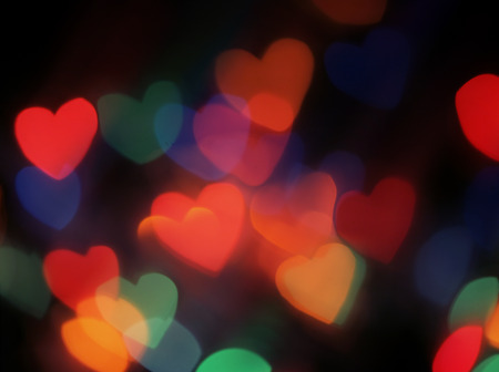 Heart shaped blurred lights. Colorful blurred bokeh lights photo