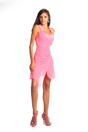 Fashionable woman in pink dress on white. photo