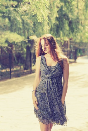 20 24 years old: Romantic women outdoors in blue dress toned image