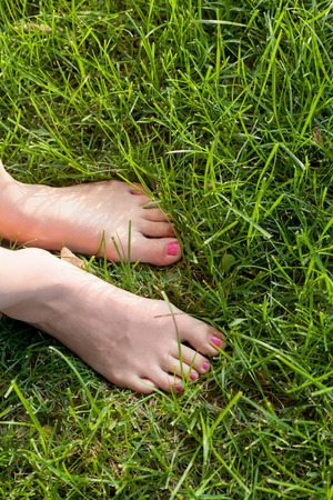 Foot over green grass. photo