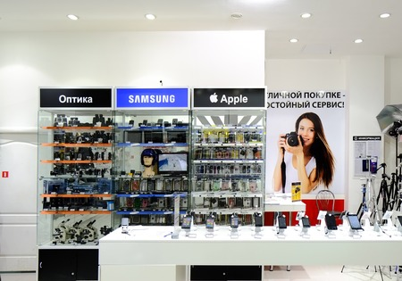 ASTRAKHAN, RUSSIA - JULY 01, 2014  Local photo and mobile devices store  Apple and Samsung devices near each other