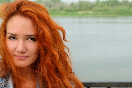 Closeup image of a young redhead women and a lot of copyspace. photo