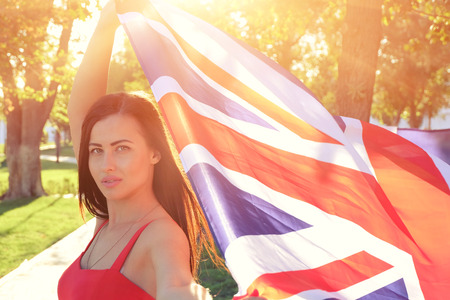 british girl: British girl holding the Jack Union flag in her hands Stock Photo