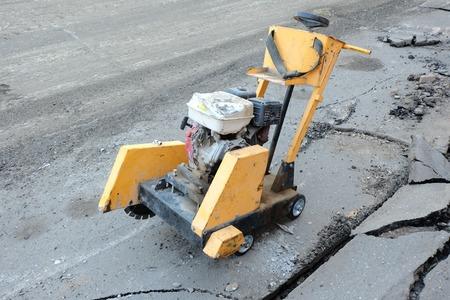 destruct: Circular small drill breaking street asphalt,Jackhammer breaking street asphalt, repairing damaged water supply Stock Photo