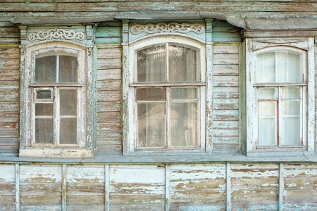 Old windows of obsolete wooden traditional Russian house photo