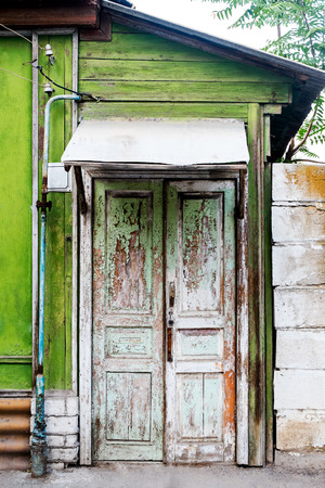 Ancient wooden door in old house wall. Astrakhan, Russia. photo