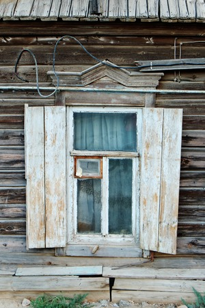 Vintage window of an aged wooden house in Russia. photo