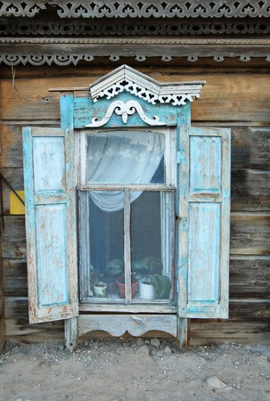 Vintage window of a old wooden house in Russia. photo