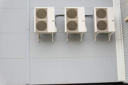 Three split-system on gray wall photo