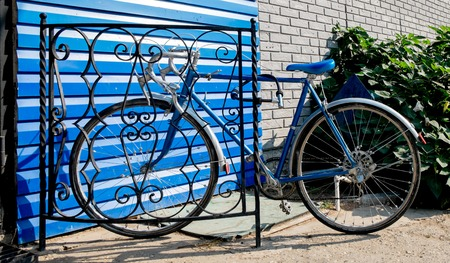 City bicycle fixed gear and blue wall, vintage bike. Retro stylish cycling in town. photo