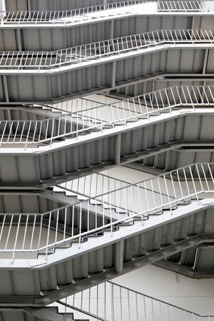 Modern fire escape ladder of gray color. photo