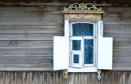 Vintage window of a old wooden house in Russia and a lot of copyspace photo