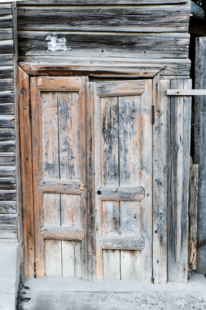 Ancient wooden door closed.  Wooden door of old barn. photo