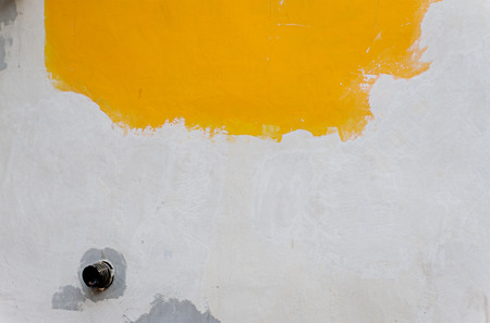 Background of old yellow painted wall. photo