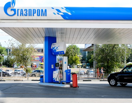 unleaded: ASTRAKHAN  RUSSIA -August 16, 2014 illustrative editorial photo of petrol station with GAZPROM Company logo. Gazprom is the most popular market leader in Russia in natural gas and petrol distribution