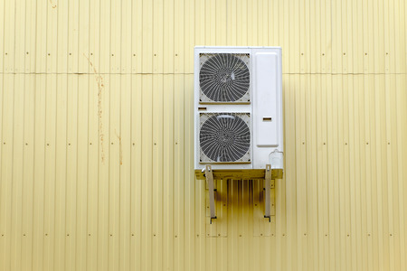 Industrial Cooling System on the metal wall and a lot of copyspace photo