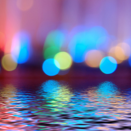 Colorful bokeh defocused lights wallpaper in blue and iolet colors. photo