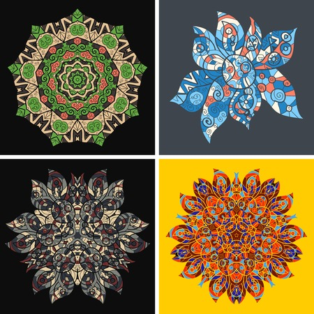 Collection of symmetric ethnic ornaments. Ornamental round floral pattern. Set of four colorful ornament. Bright circle patterns.  Vector