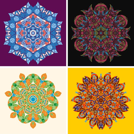 Set of 4 abstract ethnic indian hand drawn vector . Ornamental round floral pattern. Set of four colorful ornament Vector