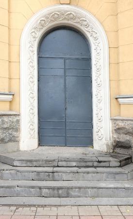 Ancient door painted in dark blue color. photo