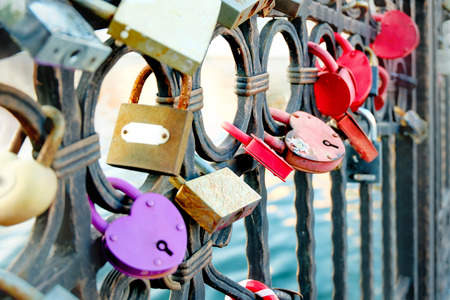 Wedding locks on bridge fence in Astrakhan, Russia photo