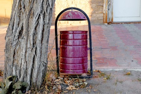 Violet trash dumpster in the street front view and a lot of copyspace photo