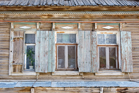 urban decay: Three old russian style wooden window in Astrakhan, Russia. Urban decay. Heritage Stock Photo