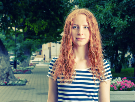 imperturbable: Ginger haired women feeling unhappy and looking at camera.  Melancholy state.