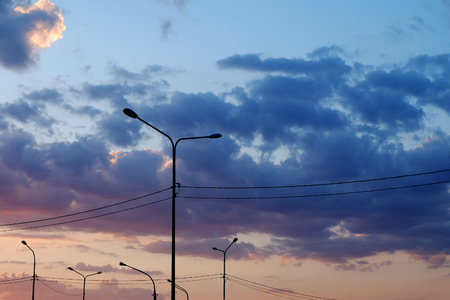 colorful cloudscape: Street lamps over colorful sunset cloudscape background Stock Photo