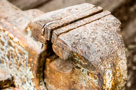 vice: Blacksmiths vice closeup. Old rusty all-steel vice-grip