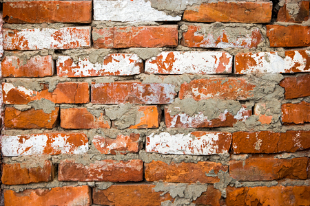 sparse: Red brick wall closeup with sparse white bricks, old obsolete texture red brick wall background