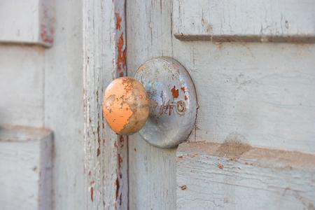 obsolete: Wood Door handle on obsolete wooden background. Stock Photo