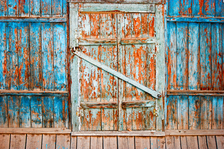 hinges: Old weathered closed shutters wooden window with hinges Astrakhan,Russia Stock Photo