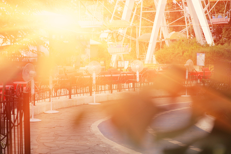 backlit: City park backlit by sunset. Stock Photo