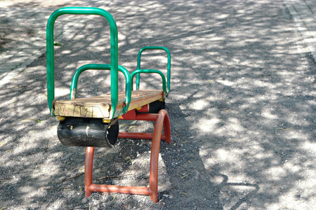 totter: Seesaw teeter in park with a lot of copyspace