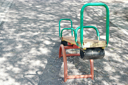 teeter: Seesaw teeter in park with a lot of copyspace