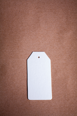 craft paper: White Paper label on a brown craft paper background a lot of copy space
