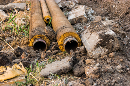 piped: Old rusty water pipes. Repair of water supply system.