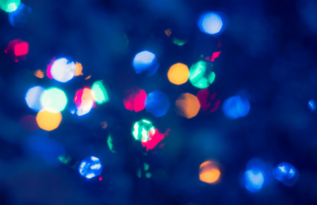 styled: Christmas night lights defocused background. Vintage styled holiday abstract bokeh retro wallpaper
