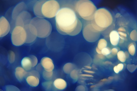 colorized: Defocused decorations. Abstract pretty bokeh, art wallpaper. Toned image. Colorized shot.