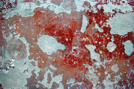 nasty: Old dirty nasty plaster and red paint on the wall surface background. Stock Photo