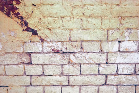 colorized: Weathered grey brick wall painted in two color for background or texture. Toned colorized image.