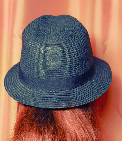 colorized: Girl in hat hipster style toned image, colorized shot Stock Photo