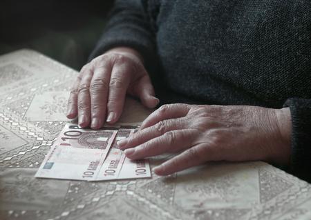 Senior woman with little euro money