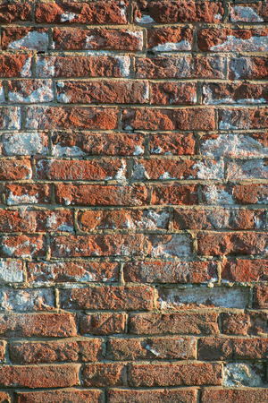 vertical image: Vertical image of a aged red brick wall of a historical building