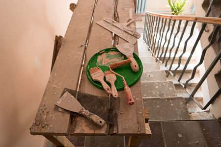 entryway: Cosmetic Repairs. Tools for renovation in Entryway of apartment building Stock Photo