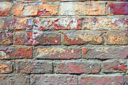 old brick wall: Old brick wall painted in red color.